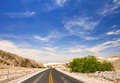 Desert road and blue sky in Death Valley national park Royalty Free Stock Photo