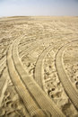Desert safari traces of tires of a wd vehicle on the sand following an off road southern qatar Stock Photography