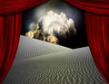 Desert sands seen through opening in curtains Royalty Free Stock Photo