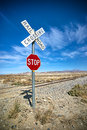 Desert stop sign and railroad crossing keep vehicles safe an isolated stretch of rails in the mojave Stock Images