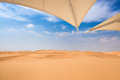Desert  with sunshade Stock Photo