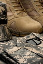 Desert tactical boots and military tag chains Stock Photos
