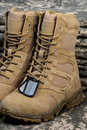 Desert tactical boots and military tag chains Royalty Free Stock Photo