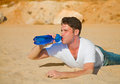 Desert traveler side on thirsty with face red of sun burn drinking water image Stock Photography