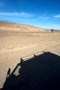 Desert travelling shadow of a four wheel drive car on a road in morocco Royalty Free Stock Photography