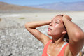 Desert woman thirsty dehydrated in death valley dehydration overheating thirst and heat stroke concept image with girl in desert Stock Photos