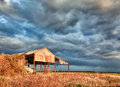 Deserted barn in storm Royalty Free Stock Image