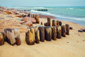 Deserted beach with old wooden column Stock Photography