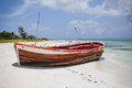Deserted boat on a beautiful beach Royalty Free Stock Image