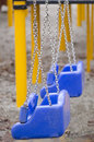 Deserted child swing Stock Image