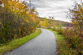 Deserted Lakeside Paved Path in Autumn Royalty Free Stock Photo