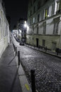 Deserted street in montmartre rue berthe paris at night Royalty Free Stock Photo