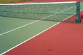 Deserted tennis court with net a divider Royalty Free Stock Photo