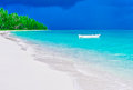 Deserted tropical beach and lonely boat island white Stock Images