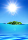 Deserted tropical island green under shiny sun in ocean Royalty Free Stock Photography