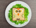 Design food. Creative sandwich for child with  picture little ow Stock Photos