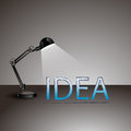 Design of lightening lamp with idea sign in front it on gray background Royalty Free Stock Photos