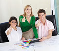 Design students holding thumbs up Royalty Free Stock Photography