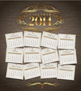 Design template calendar of with golden ornate elements on a wooden background Stock Photo