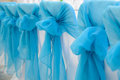 Design of wedding chairs with blue bows. Royalty Free Stock Photo