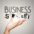 Design word business strategy as concept close up hand showing Royalty Free Stock Photos