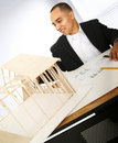 Designer Building A House Model Royalty Free Stock Photography