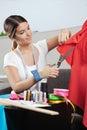 Designer cutting red fabric Stockbild