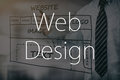 Designer drawing website development. Royalty Free Stock Photo