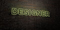 DESIGNER -Realistic Neon Sign on Brick Wall background - 3D rendered royalty free stock image Royalty Free Stock Photo