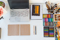 Designer workplace top view. Painter desk with drawing equipment. Home studio for artist. Royalty Free Stock Photo