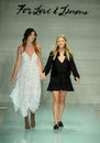Designers Tess Hamilton and Ali Hoffmann walk the runway finale during For Love and Lemons Spring Summer 2017 Runway Show Royalty Free Stock Photo