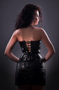 image photo : Desired brunette woman posing in leather corset