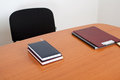 Desk with books and documents Royalty Free Stock Photography