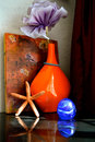 Desk decore top vignette with painting vase paperweight and starfish Stock Photo