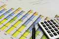Desk with financial charts and histograms