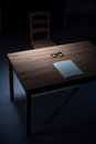 Desk in interrogation room Royalty Free Stock Photo
