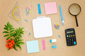 Desk with paper, pen, calculator, magnifier and ruler Royalty Free Stock Photo