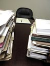 Desk with piles of files pad paper and Stock Photo