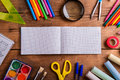 Desk, school supplies, squared paper, wooden background, copy sp Royalty Free Stock Photo