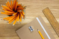 Desk supplies on wooden desk top Royalty Free Stock Photo