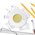 Desktop architect drawings tools engineer and a cup of coffee Royalty Free Stock Photo