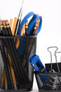 Desktop baskets with pencils and clips Royalty Free Stock Photo