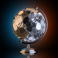 Desktop business globe created out of money on artistic background Stock Image