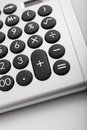 Desktop calculator symbol of financial operations close up the buttons a economy or Royalty Free Stock Photo