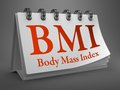 Desktop calendar with bmi concept body mass index red text on white Royalty Free Stock Photo