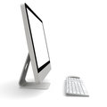 Desktop computer modern with white blank screen on white background Stock Image