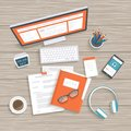 Desktop with monitor, keyboard, documents, folder, headphones, phone. Wooden table top view. Workplace background. Royalty Free Stock Photo