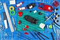 Desktop view from above of assembly and painting of a red retro scale model car vehicle concept background. modeling tools Royalty Free Stock Photo