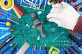 Desktop view from above of assembly and painting of retro scale model fighter plane concept background. modeling tools airbrush Royalty Free Stock Photo