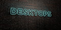 DESKTOPS -Realistic Neon Sign on Brick Wall background - 3D rendered royalty free stock image Royalty Free Stock Photo